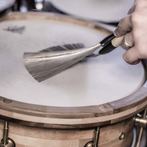 Brushes on snare drum demonstrating the brushes drum groove