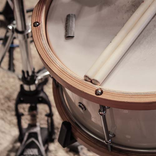 White snare drum with wooden hoops used on this Reggae one drop groove