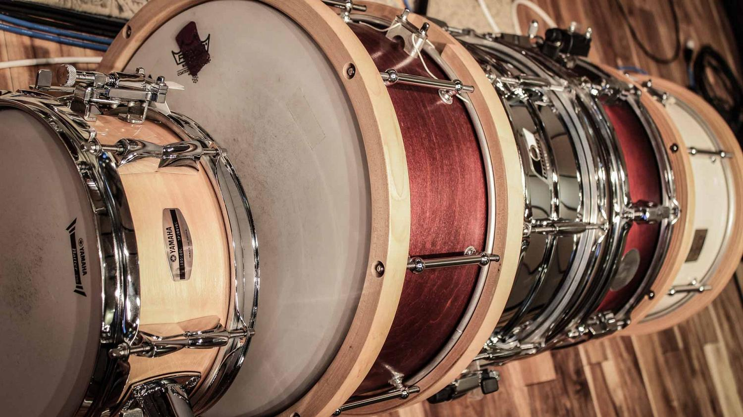 A variety of snare drums, both wooden and metal, available for online drum tracks to suit a variety of music genres and styles