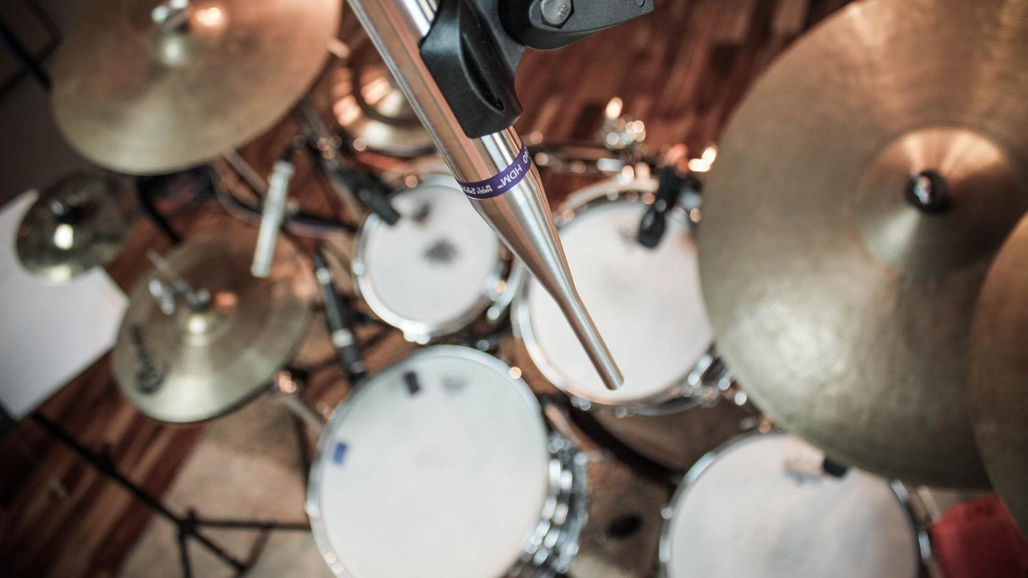 High quality omni mics are placed over acoustic drums to capture them as authentically as possible